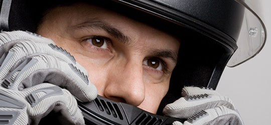 Close up of motorcyclist wearing a helmet. California motorcycle attorney Frank D. Penney gives tips on choosing the right helmet