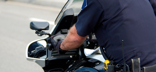Close up of motorcycle law enforcement official on a motorcycle. California motorcycle attorney Frank D. Penney provides a list of motorcycle law resources